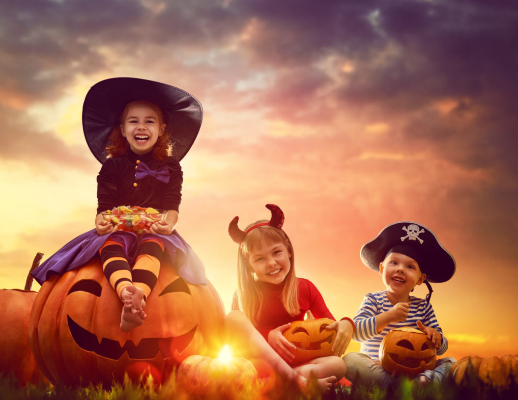 Happy,brother,and,two,sisters,on,halloween.,funny,kids,in